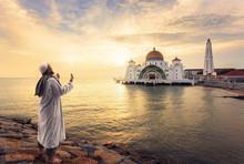 Muslim Pray At The Malacca Straits Mosque ( Masjid Selat Melaka) Near Malacca Town, Malaysia
