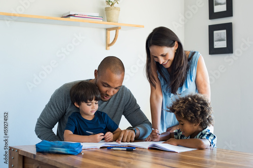 Photo Parents helping children with homework