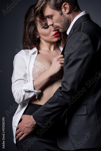 Young Passionate Couple Embracing And Able To Kiss In Erotic Scene