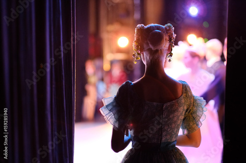 A ballerina awaiting the moment of entering the stage in the play Wallpaper Mural