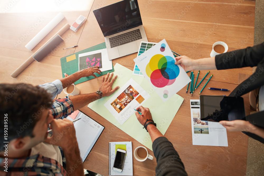Fototapeta Young designers discussing the color palette - obraz na płótnie
