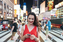 Beautiful Woman Using Phone In...