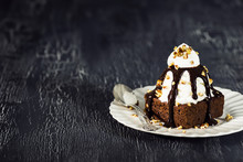 Chocolate Brownie Sundae With Hot Fudge, Whipped Cream, And Nuts
