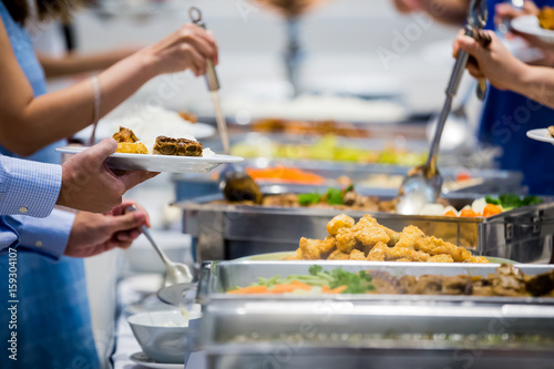 In de dag Buffet, Bar people group catering buffet food indoor in luxury restaurant with meat colorful fruits and vegetables