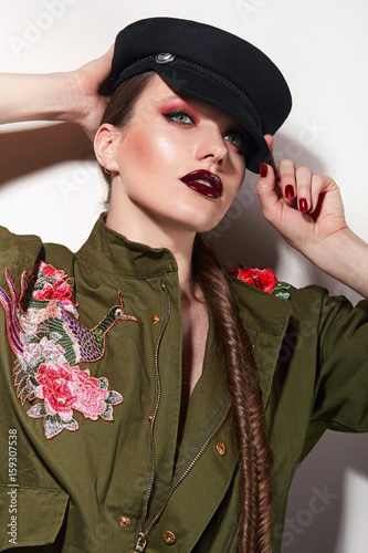 Beautiful Young Girl With Bright Make Up In A Green Trench Coat And