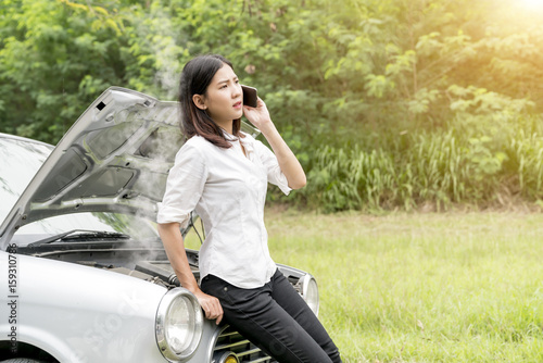 Asian woman worry about car failure and used mobile phone. - Buy ...