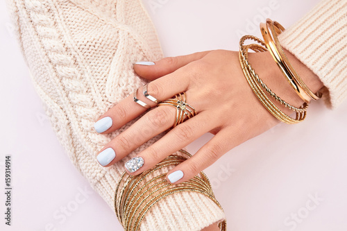 Fotografie, Obraz  Close-up of female jewelry on hands.