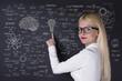 Business woman working on the blackboard