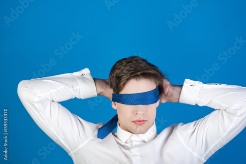 Fotografie, Obraz  tie on face and eyes of young blindfolded man, businessman