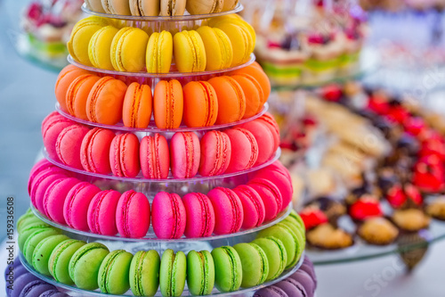 Staande foto Macarons Delicious french macarons and cake dessert on plates