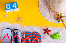 July 4th. Image Of July 4 Calendar With Summer Beach Accessories And Traveler Outfit On Background. Summer Vacation Concept