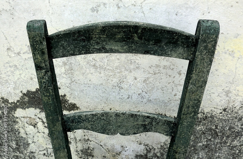 Vintage background, old backrest and damaged white wall Canvas Print