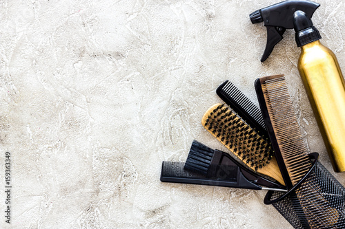 Professional hairdressing tools and accessories on stone table background top view copyspace