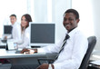 Portrait of happy afro-american businessman with colleagues wo