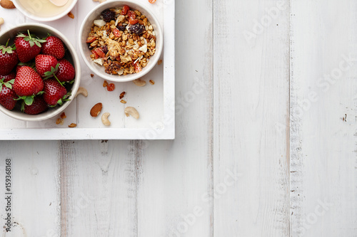 Healthy cereal breakfast with fresh strawberry and honey Canvas Print