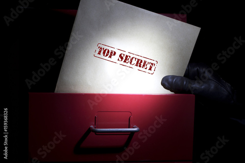 Photo Looking for top secret documents in a dark.
