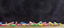Colorful Chalks And A Blackboard