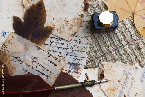 Foto op Canvas Praag Still life. Old paper. Quill, ink and dry leaves on knitted straw. Recipe. .