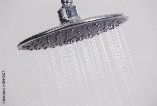close up of rain shower head in bathroom