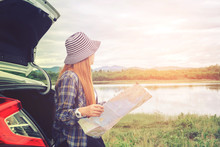 Happy Beautiful Girl Traveling In A Hatchback Car With Map