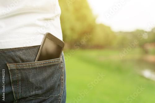 Fotomural  Smartphone in back pocket of a man's jeans