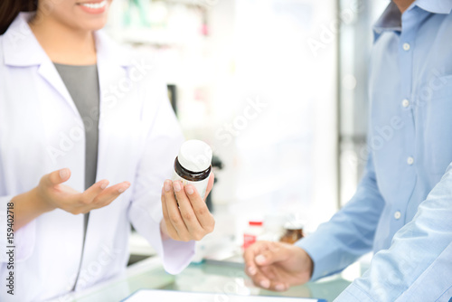 Poster Pharmacie Pharmacist giving advice to customer in drugstore