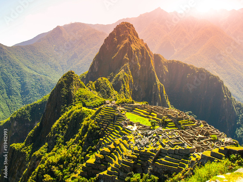 Ancient Inca City of Machu Picchu illuminated by sun Wallpaper Mural