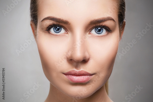 Fotografie, Obraz  Beautiful face of young woman with perfect skin.