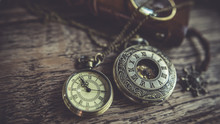 Vintage Pocket Watch Necklace On Wooden Texture Background.