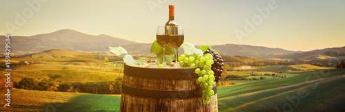 Printed kitchen splashbacks Beige Red wine with barrel on vineyard in green Tuscany, Italy