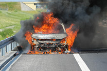 Car Burning On A Highway