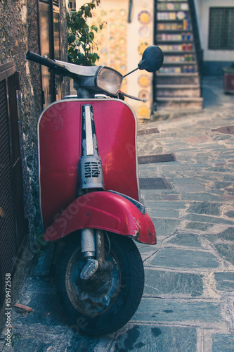 Foto op Canvas Scooter Vintage italian scooter in a alley of historic city center