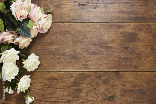 Fotobehang Bloemen Roses on rustic wood background