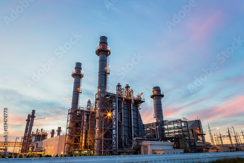 Poster Industrial geb. Refinery plant of a petrochemical industry at night