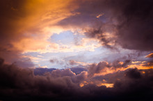 Storm Clouds In The Sunset Light