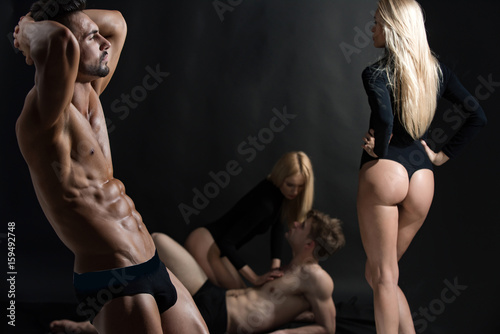athlete man with muscular body with twin girls