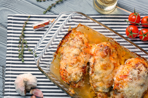 Fotografie, Obraz  Delicious chicken parmesan meal with cheese and sauce in baking dish