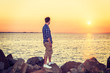 Young Man Watching Sunset