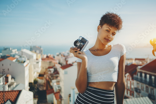 f40b7c902616b Serious attractive afro american female journalist with retro film photo  camera
