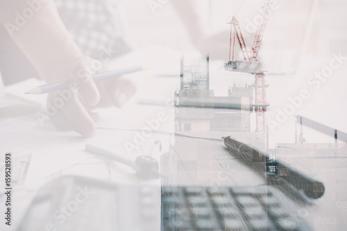 Architect working on real estate project at workplace male engineer architect working on real estate project at workplace male engineer hand working with living house malvernweather Images