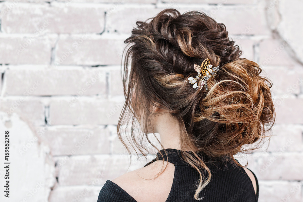 Fototapeta attractive young brunette woman with beautiful hairstyle with hair detail accessory, closeup rear view