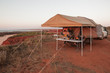 Off Road Camper Trailer set up on top of cliffs with stunning ocean views at James Price Point, Kimberley, Australia.