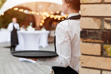 Waiter Holding An Empty Tray I...