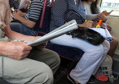 A passenger reads a newspaper on a train ride into Vienna