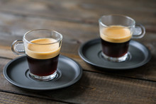 Two Cups Of Espresso On A Wooden Table