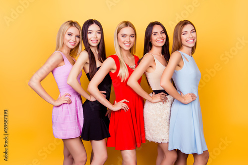 Excited Girlfriends In Colorful Short Cocktail Dresses Are Ready For Birthday Celebration Party Charming And Cute Pretty Elegant