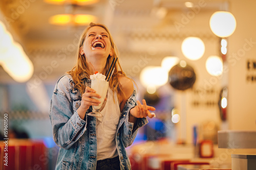Stickers pour portes Lait, Milk-shake Woman drinking milkshake at the restaurant