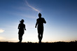 silhouette of a jogger couple in sunrise