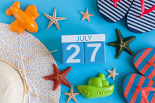 July 27th. Image Of July 27 Calendar With Summer Beach Accessories And Traveler Outfit On Background. Summer Day, Vacation Concept