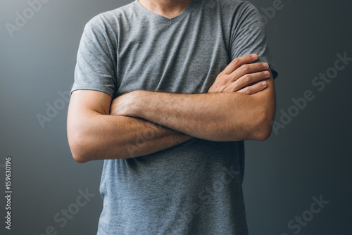 Fotografie, Obraz Casual adult man with arms crossed, body language
